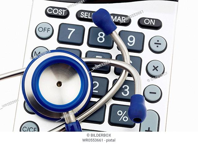 A stethoscope and a calculator.Costs of health and medicine