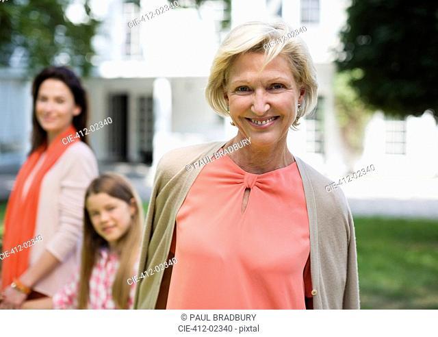 Three generations of women walking outdoors