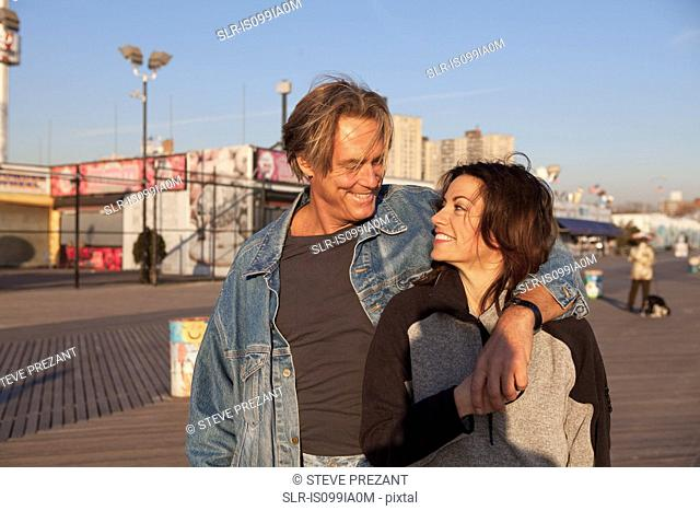 Happy mature couple on promenade