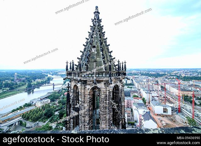 Germany, Saxony-Anhalt, Magdeburg, view of the north tower of the Magdeburg cathedral, on the left the lifting bridge and the city park