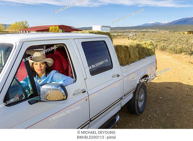 Hispanic woman driving truck