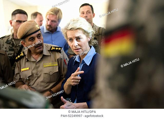 German Minister of Defence Ursula von der Leyen (CDU, C) talks to soldiers of the German Armed Forces at a barracks at which Kurdish Peshmerga fighters are...