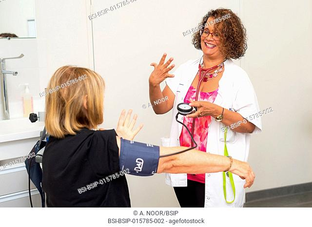 Care for deaf patients in sign language, Nice Hospital, France. Consultation with a 60-year old patient. This woman suffers from hypertension and depression due...