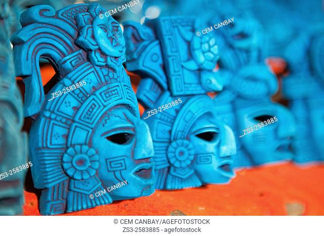 Souvenirs of blue masks at the market stall in town center, Isla Mujeres, Cancun, Quintana Roo, Yucatan Province, Mexico, Central America