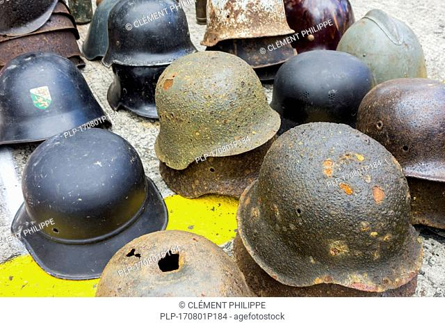 German World War Two helmets for sale at stand of WW2 militaria fair
