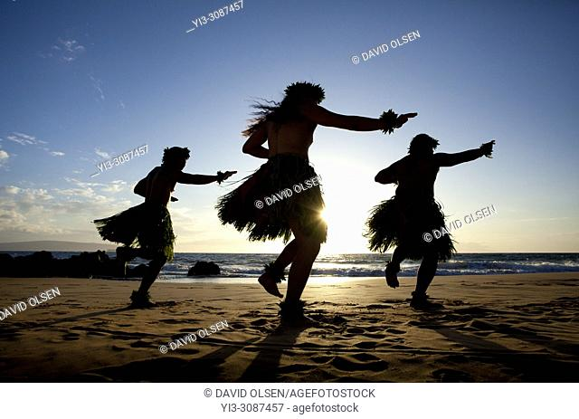 Three hula dancers at sunset, Maui, Hawaii