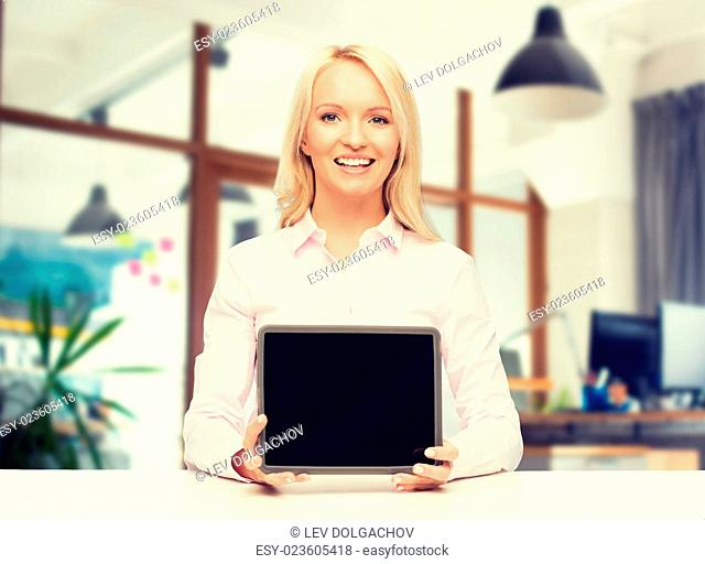 education, business and technology concept - smiling businesswoman or student showing tablet pc computer blank screen over office room background