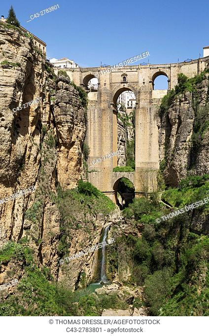 The White Town of Ronda high above the river gorge El Tajo (though the river itself is the Guadalevin). Malaga province, Andalusia, Spain