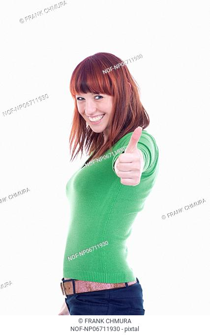 young cheerful woman showing thumbs up sign - isolated on white