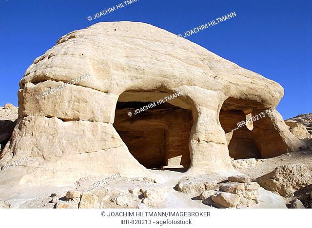 Caves along the Bab Al-Siq Valley leading up to the Siq or gorge, the entrance to the ancient Nabataean rock city of Petra, Wadi Musa, Valley of Moses, Jordan