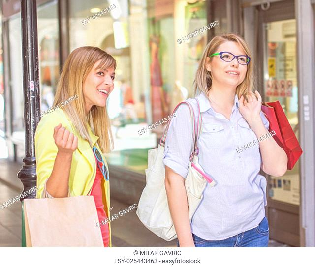 Shopping Female Friends with bags on the street