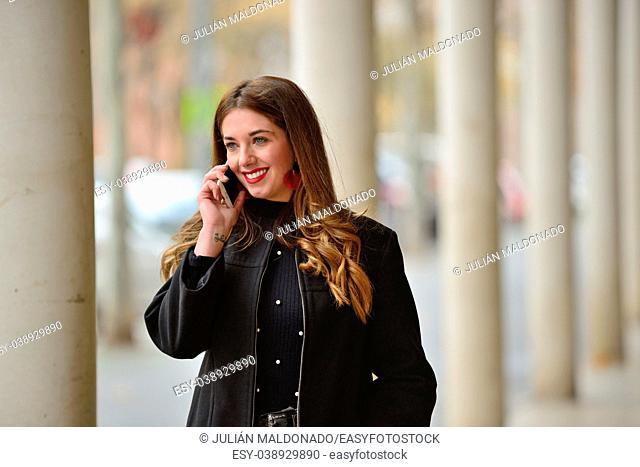 Young woman communicating by mobile