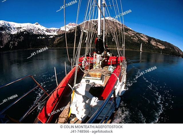 Yacht breaking ice while cruising up west arm of Seno Pia Isla Grande Tierra del Fuego Chile