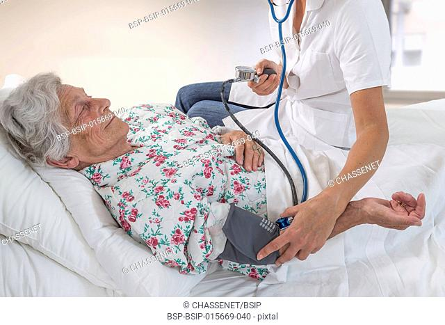 Doctor measuring a patient's blood pressure