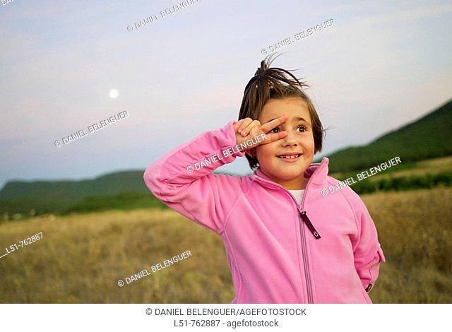 Child joking at sunset, Talayuelas, Cuenca, Castilla la Mancha, Spain, Europe