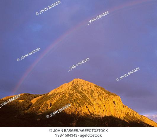 Rainbow and storm clouds over Crested Butte, Gunnison National Forest, Colorado, USA