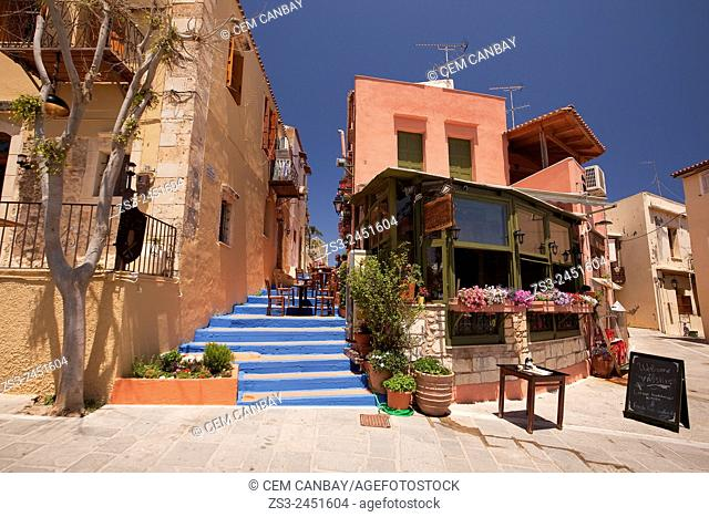 Colorful stairs leading to a restaurant in town center, Rethymno, Crete, Greek Islands; Greece, Europe