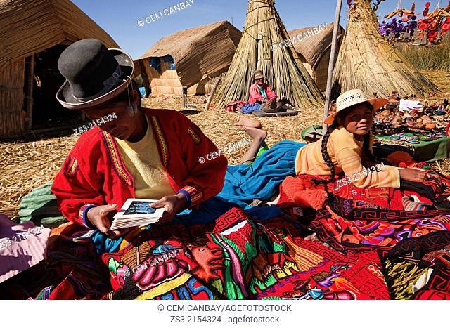 Aymara indigenous women selling crafts, Uros Islands, Lake Titicaca, Puno Region, Peru, South America