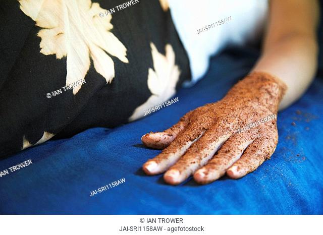 Woman with hand scrub for manicure, Kandy, Sri Lanka MR
