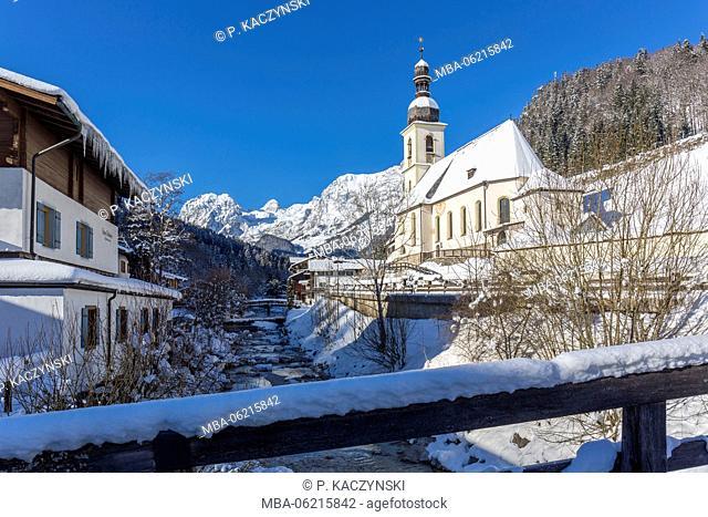Parish Church Sankt Sebastian and the mountain creek Ramsauer Ache in front of Reiteralpe, Ramsau, winter, Berchtesgaden, Bavaria, Germany