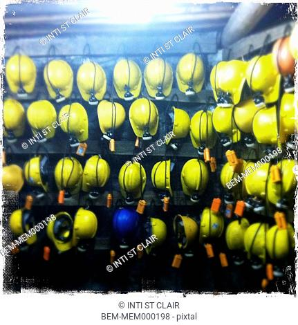 Hard-hats hanging in a row