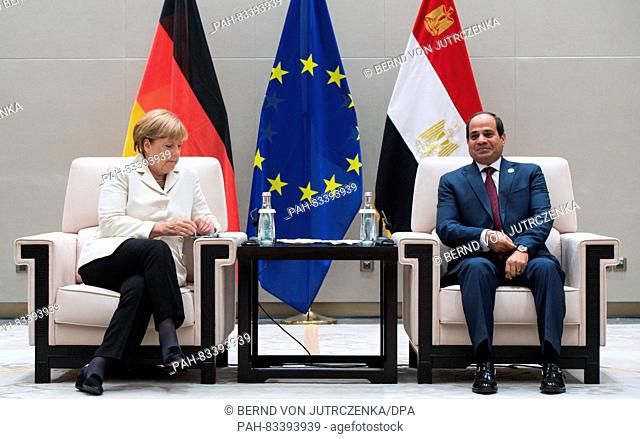 German Chancellor Angela Merkel (L) and Egyptian President Abdel Fattah el-Sisi (R) meet for talks at the G20 Summit in Hangzhou, China, 05 September 2016