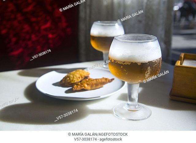 Two glasses of beer with tapa in a cafe. Spain