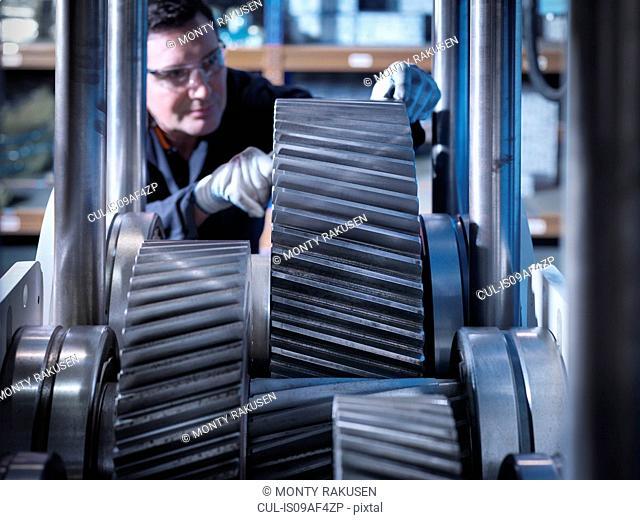 Engineer working on industrial gearbox