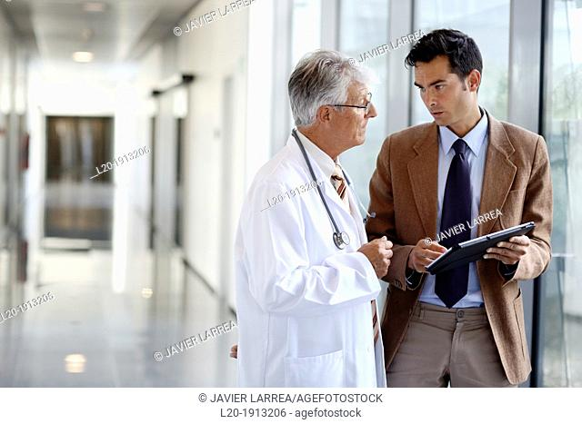 Doctor attending to seller, Corridor, Onkologikoa Hospital, Oncology Institute, Case Center for prevention, diagnosis and treatment of cancer, Donostia
