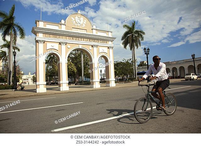 Cyclist in front of the Triumphal Arch-Arco de Triunfo in Jose Marti Park-Parque Jose Marti, Cienfuegos, Cienfuegos Province, Cuba, West Indies, Central America