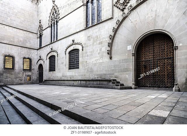 Ancient door entrance to city hall in gothic quarter of Barcelona
