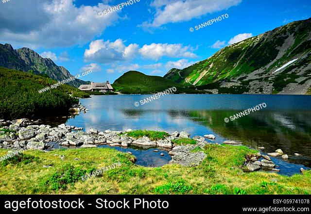 The beautiful lake Przedni Staw and the mountain lodge Schronisko Piec Stawow in the High Tatras, Poland