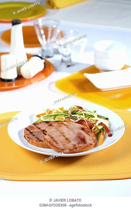 Marinated loin of pork with sauteed vegetables