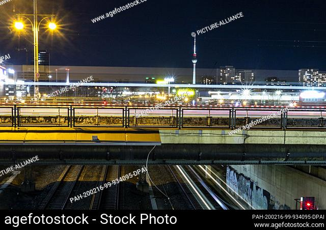 16 February 2020, Berlin: The vehicles on the Warsaw Bridge can only be recognized as colored light strips (long exposure)