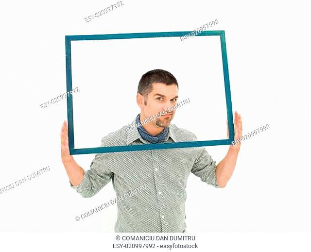 grumpy man holding a frame