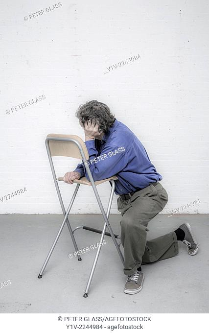 Man leaning on a chair