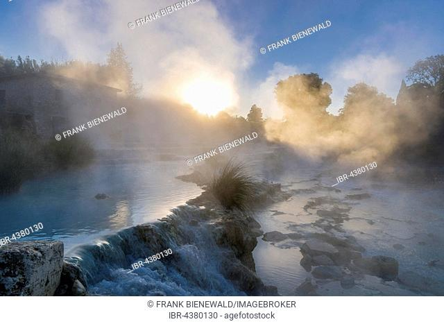 Steam is arising from the hot springs of Saturnia Therme in the morning, Saturnia, Tuscany, Italy