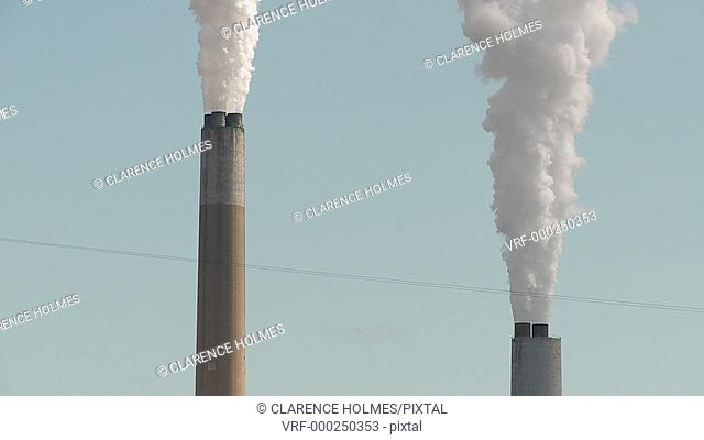 Industrial chimneys at the Bruce Mansfield Power Station, a coal-fired power station owned and operated by FirstEnergy on the Ohio River near Shippingport