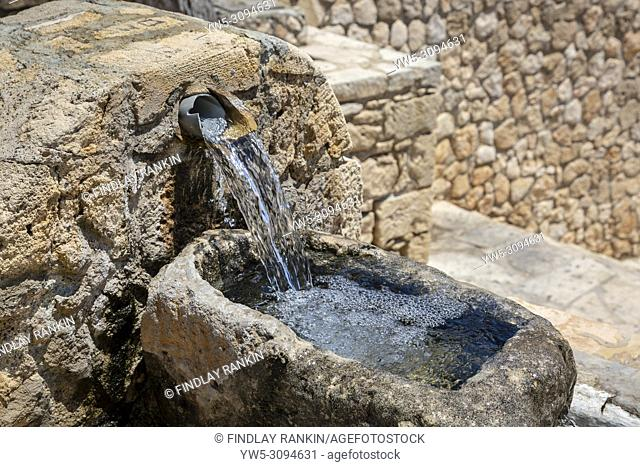 Fresh spring water pouring from a public wter spout, Ayia Napa, Cyprus