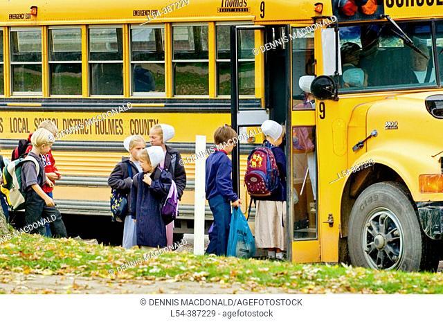 Amish life in Millersburg and Sugrar Creek Holms County Ohio School children boarding a school bus