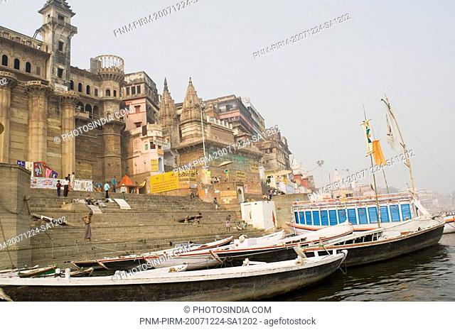 Boat moored at the riverbank, Darbhanga Ghat, Ganges River, Varanasi, Uttar Pradesh, India