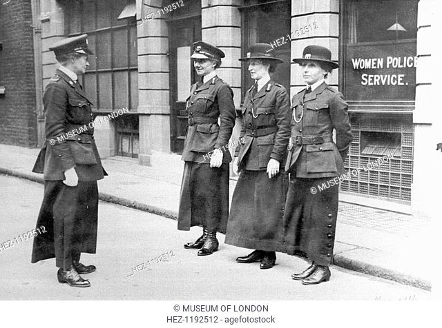Policewomen being inspected by Mary S Allen in London, May 1915. Mary S Allen, on the left, had been a WSPU organiser and had a vivid career as a suffragette