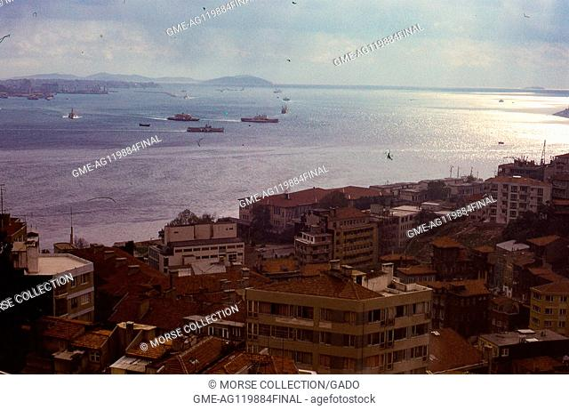 Panoramic view of the Bosphorus strait facing south toward the Sea of Marmara, in Istanbul, Turkey, November, 1973. Large boats and small vessels crowd the...