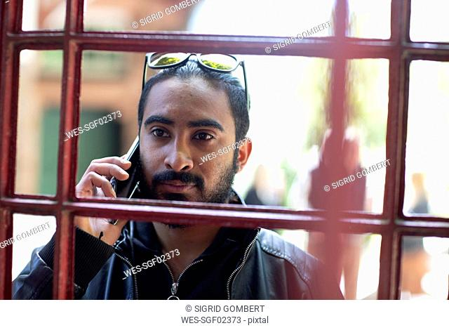 Portrait of bearded young man on the phone