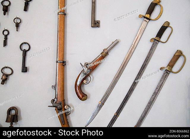 Retro pistols with sabre on wall