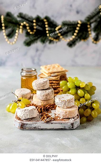 Christmas Cheese Platter, Variety of French Cheeses, Green Grapes, Walnuts, Honey and Crackers, copy space for your text