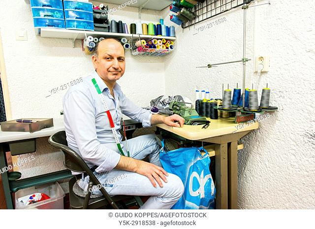 Tilburg, Netherlands. Syrian refugee Ahmad Khalil integrated succesfully into Dutch society by setting up his own, small business as King's Taylor