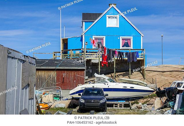 20.06.2018, Gronland, Denmark: A blue residential building in the coastal town of Ilulissat in western Greenland. The city is located on the Ilulissat Icefjord