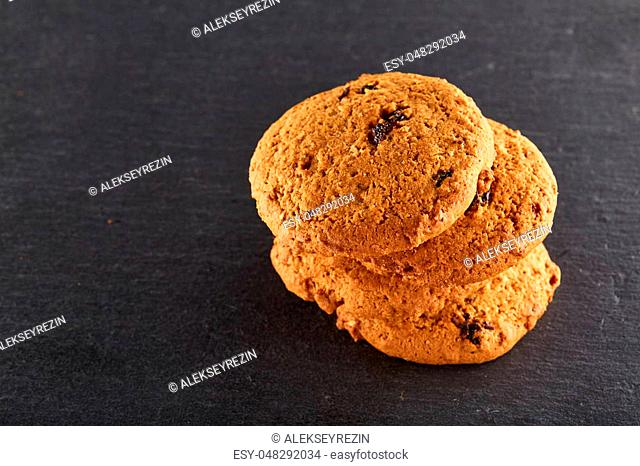 Freshly baked chocolate chips cookies isolated on black background, macro, close-up, shallow depth of field