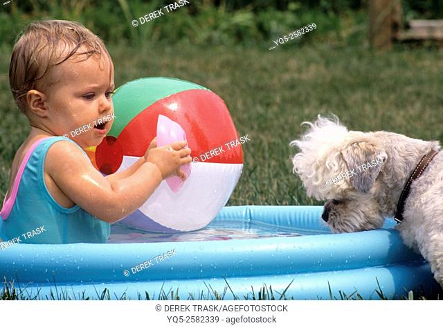 North America, Canada, Ontario, child playing in plastic inflatible pool